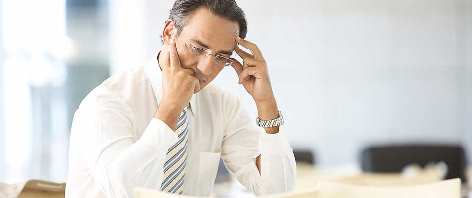Man on the phone - Why You Need a Customer Communications Solution for Correspondence and Documents