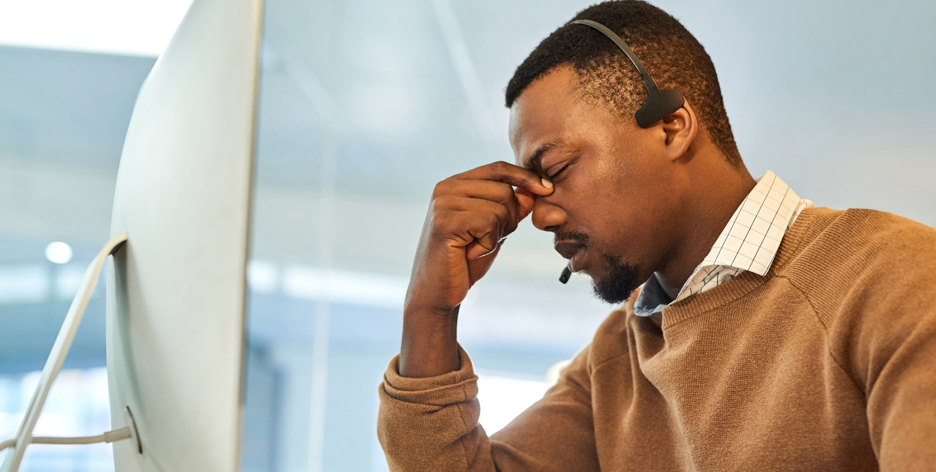 Frustrated man working at laptop - Why Do Insurers Struggle to Create Personalized Letter Correspondence