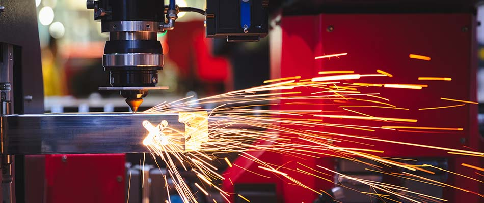 Sparks flying from cutting sheet metal in factory production