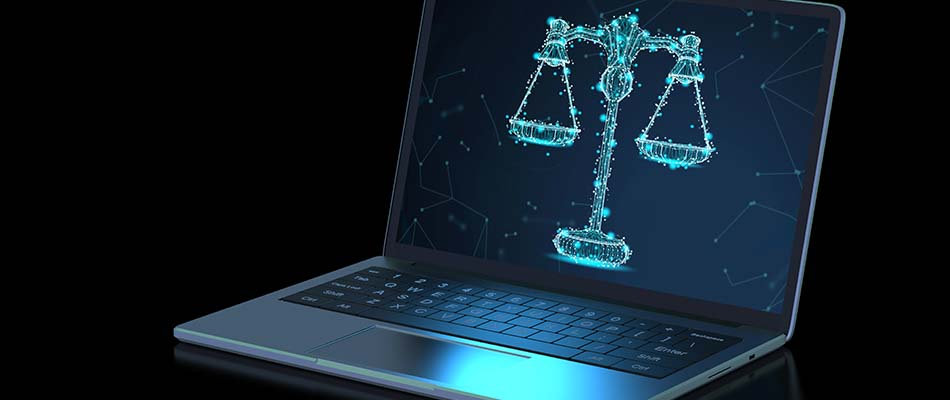 Computer and scales of justice